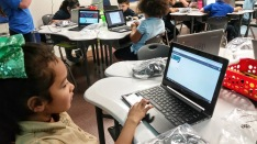 Student using Google Classroom.