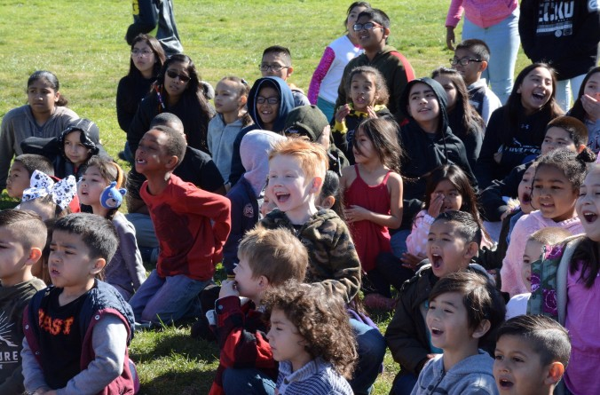 A picture of young students watching the launch.